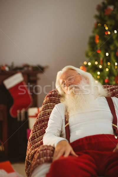 Santa claus resting on the armchair Stock photo © wavebreak_media