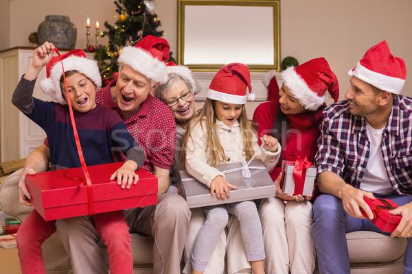 ünnepi többgenerációs család nyitás ajándékok együtt otthon Stock fotó © wavebreak_media