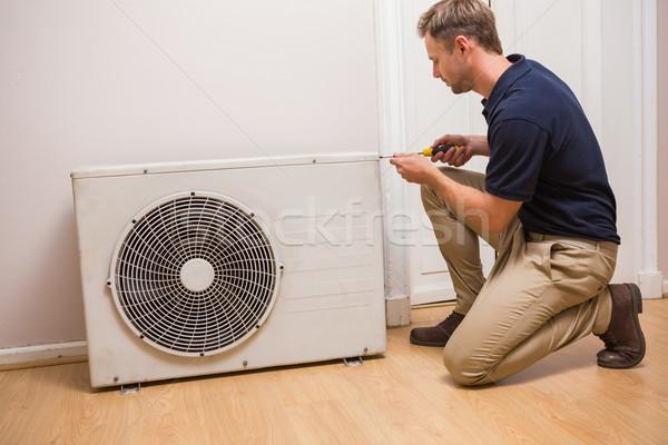 Focused handyman fixing air conditioning Stock photo © wavebreak_media