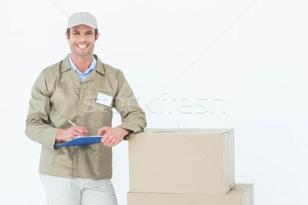 Feliz mensajero escrito portapapeles cartón cajas Foto stock © wavebreak_media