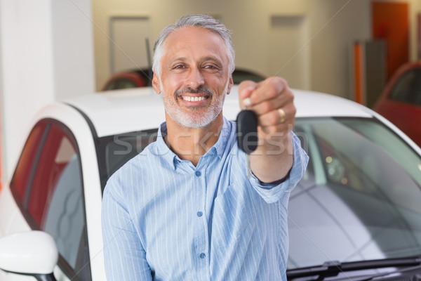 Smiling customer showing his new key  Stock photo © wavebreak_media