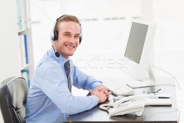 Smiling businessman speaking with headset Stock photo © wavebreak_media