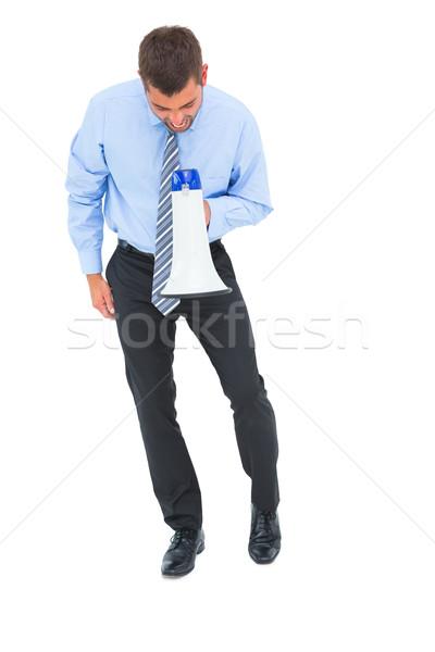 Businessman shouting through megaphone Stock photo © wavebreak_media