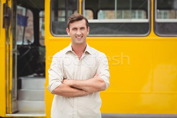 Sorridere bus driver piedi braccia incrociate uomo Foto d'archivio © wavebreak_media