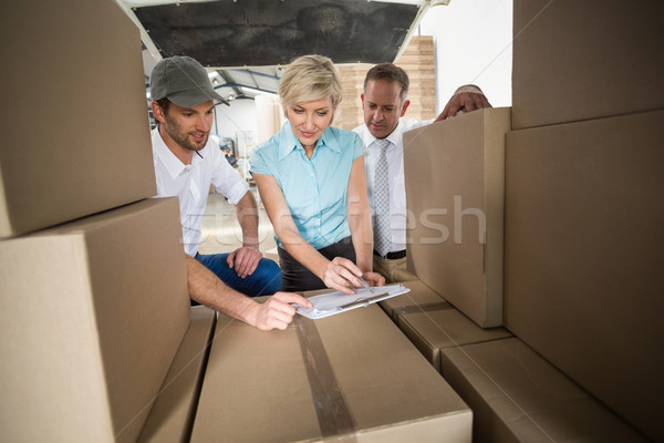 Warehouse team working together with clipboard Stock photo © wavebreak_media