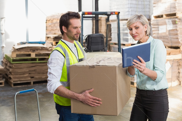 Stock photo: Warehouse worker and manager using tablet pc