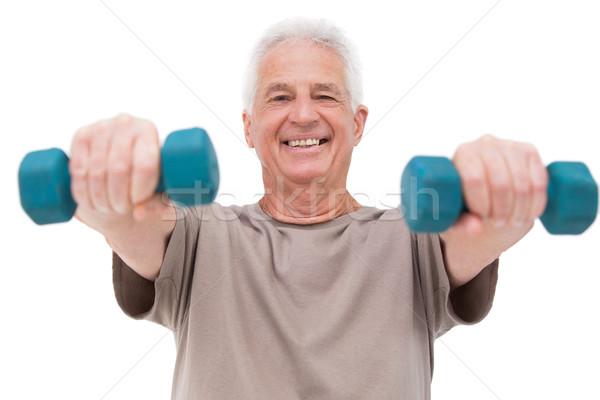 Senior man lifting hand weights Stock photo © wavebreak_media