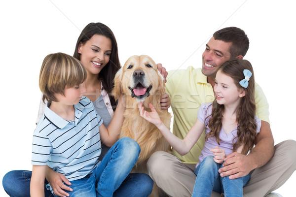 Family stroking dog Stock photo © wavebreak_media