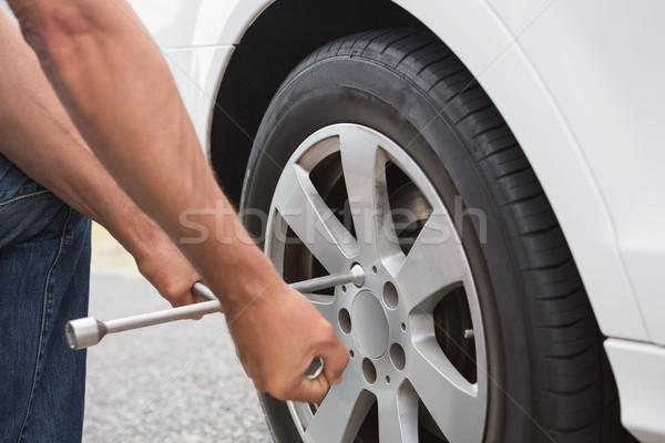 Man fixing tire  Stock photo © wavebreak_media