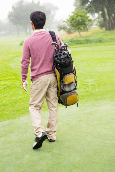 Jogador de golfe caminhada longe saco de golfe campo de golfe Foto stock © wavebreak_media