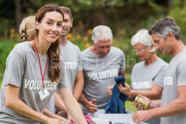 Happy volunteer looking at donation box  Stock photo © wavebreak_media