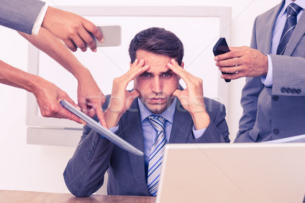 Stock photo: Worried businessman with head in hands