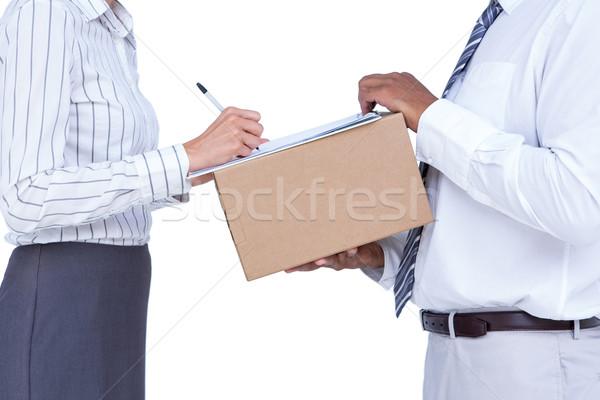 Geschäftsfrau Unterzeichnung Papiere Paket weiß Frau Stock foto © wavebreak_media