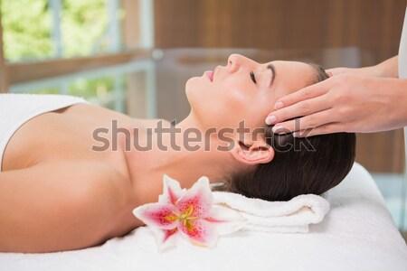 Attractive young woman receiving facial massage at spa center Stock photo © wavebreak_media