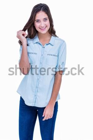 Csinos hipszter kezek csípők mosolyog kamera Stock fotó © wavebreak_media