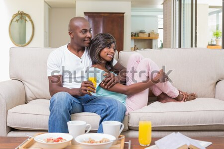 Casual father and daughter looking at photo album Stock photo © wavebreak_media
