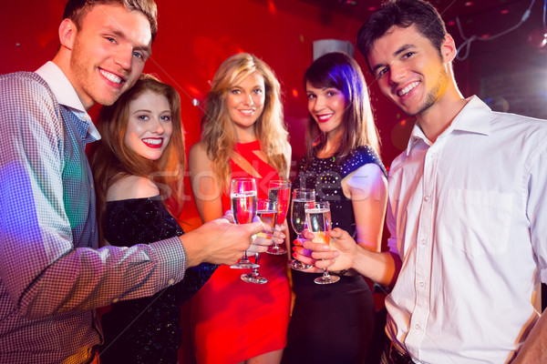 Happy friends on a night out together Stock photo © wavebreak_media
