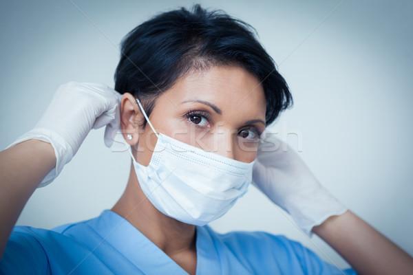 Female dentist wearing surgical mask Stock photo © wavebreak_media