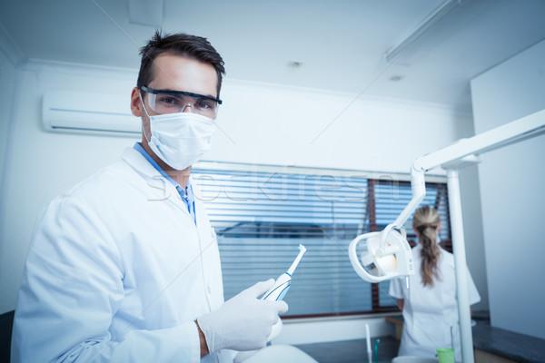 Male dentist wearing surgical mask Stock photo © wavebreak_media