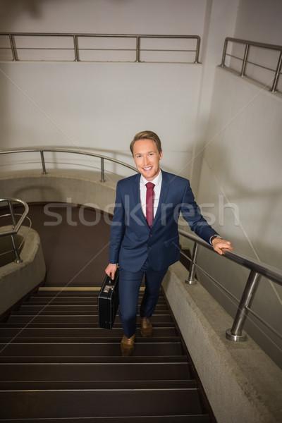 Empresário para cima escada prédio comercial edifício escolas Foto stock © wavebreak_media