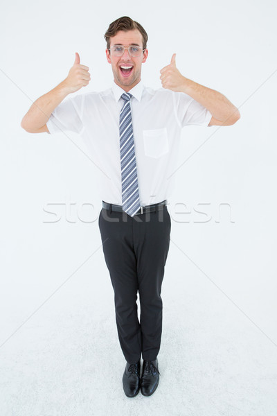 Happy geeky businessman with thumbs up  Stock photo © wavebreak_media