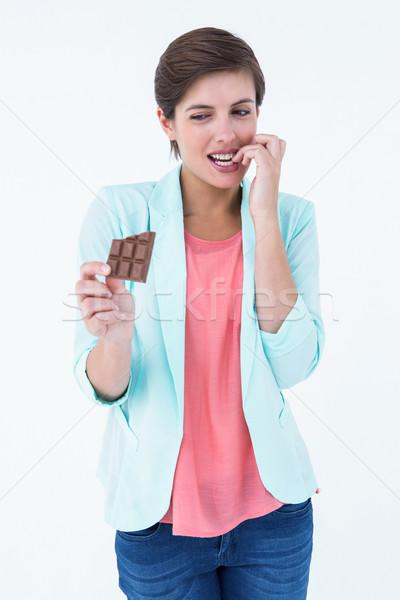 Donna mangiare cioccolato non bianco Foto d'archivio © wavebreak_media