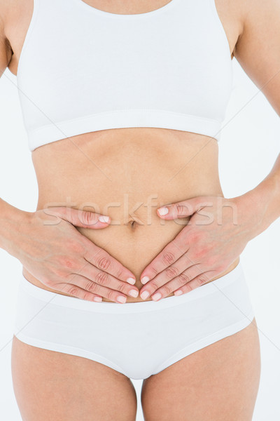 S'adapter femme souffrance estomac douleur blanche Photo stock © wavebreak_media