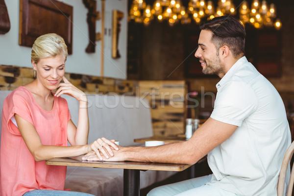 Aranyos pár randevú kéz a kézben megbeszél kávézó Stock fotó © wavebreak_media