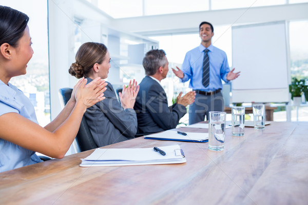 üzletemberek tapsol megbeszélés iroda nő férfi Stock fotó © wavebreak_media