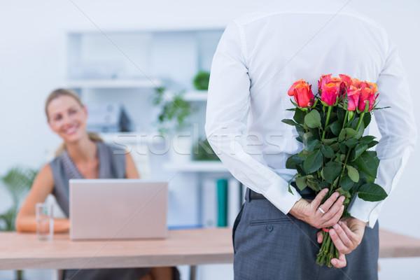 Empresario ocultación flores detrás atrás colega Foto stock © wavebreak_media