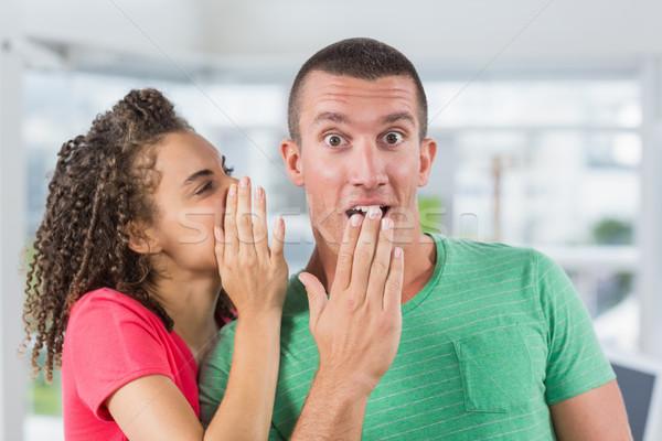 Casual businesswoman whispering secret to her colleague Stock photo © wavebreak_media
