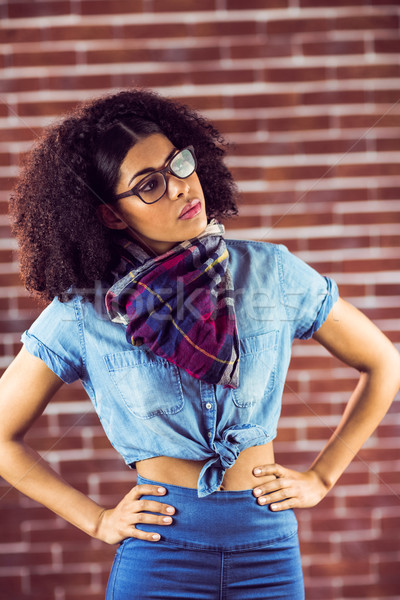 Attractive hipster posing with hands on hips Stock photo © wavebreak_media