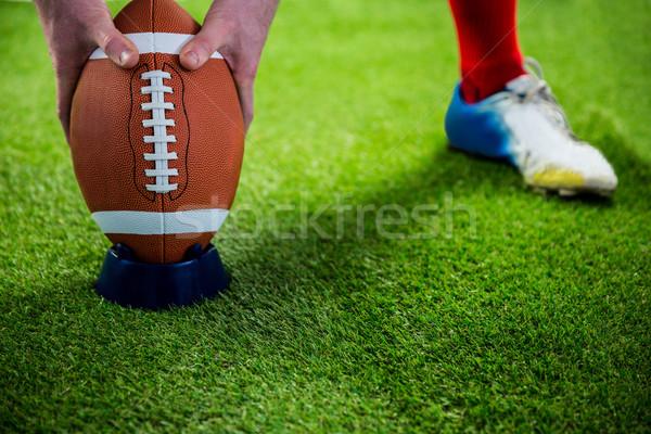 Amerikai futballista csepp rúgás futballpálya fű Stock fotó © wavebreak_media