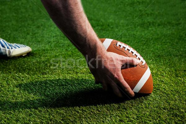 Americano futbolista caída patear campo de fútbol hierba Foto stock © wavebreak_media