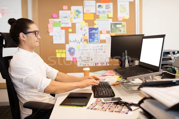 Businessman working at creative office desk Stock photo © wavebreak_media