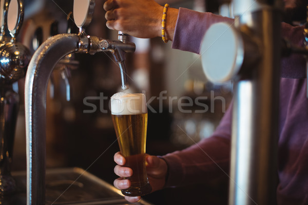 Close-up of bar tender filling beer from bar pump Stock photo © wavebreak_media