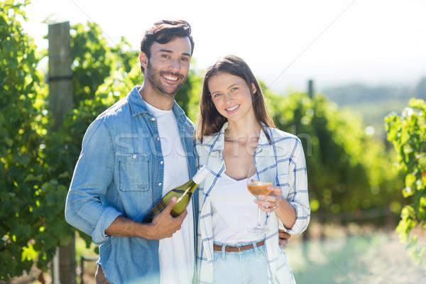 Portrait of smiling couple with wine Stock photo © wavebreak_media