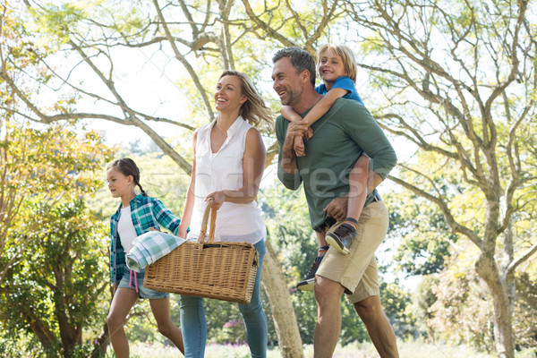 Family arriving in the park for picnic on a sunny day Stock photo © wavebreak_media