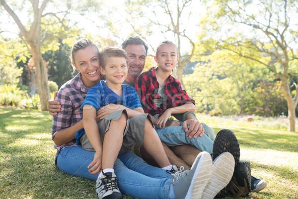 Happy family sitting in the park Stock photo © wavebreak_media