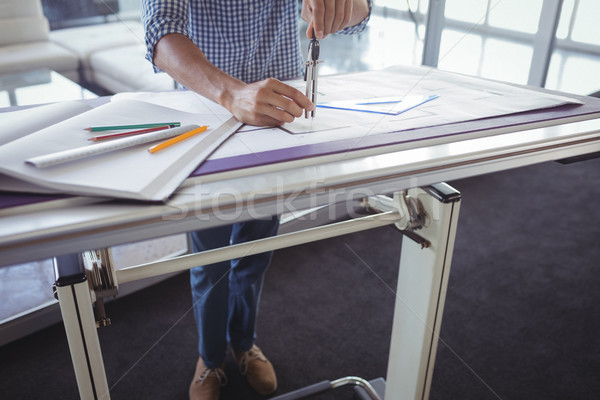 Low section of male interior designer making diagram Stock photo © wavebreak_media