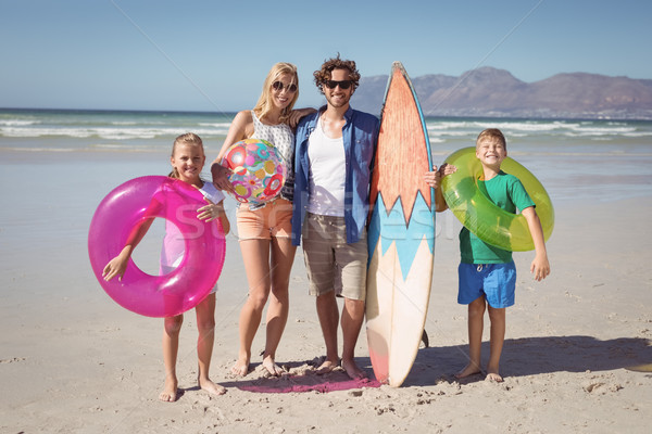 Portrait of happy family standing at beach Stock photo © wavebreak_media