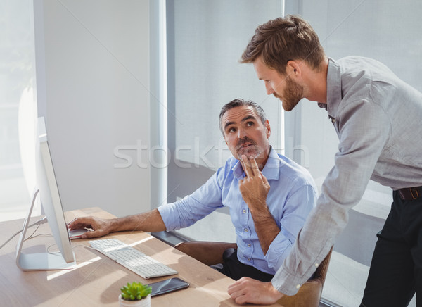 Executives interacting while working at desk Stock photo © wavebreak_media