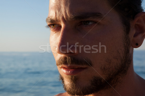 Close up of thoughtful man at beach Stock photo © wavebreak_media