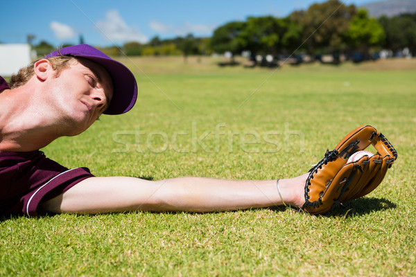 Baseball pitcher catching ball while diving on field Stock photo © wavebreak_media