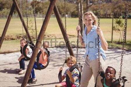 Boldog iskolás gyerekek játszik játszótér iskola lány Stock fotó © wavebreak_media