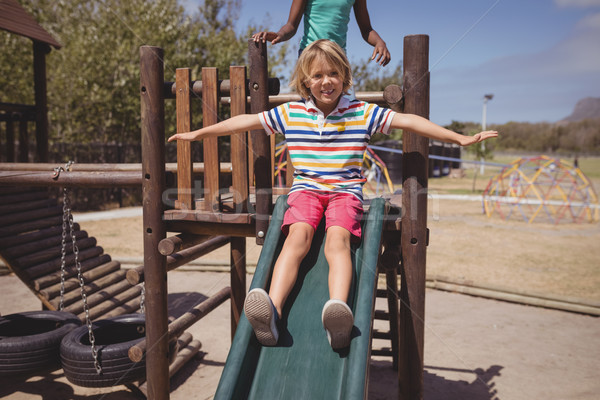 écolier jouer slide école aire de jeux Photo stock © wavebreak_media