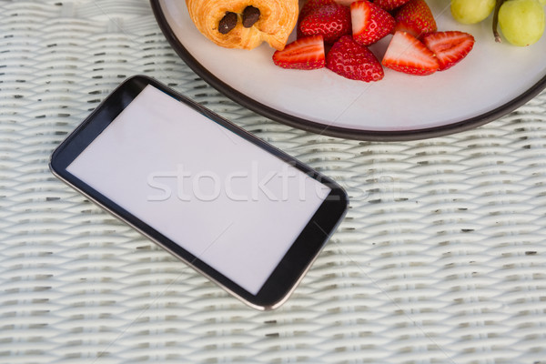 Mobile phone by fruits on table at cafe Stock photo © wavebreak_media