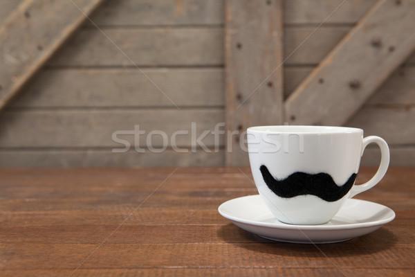 Tazza di caffè baffi tavola tavolo in legno legno Foto d'archivio © wavebreak_media