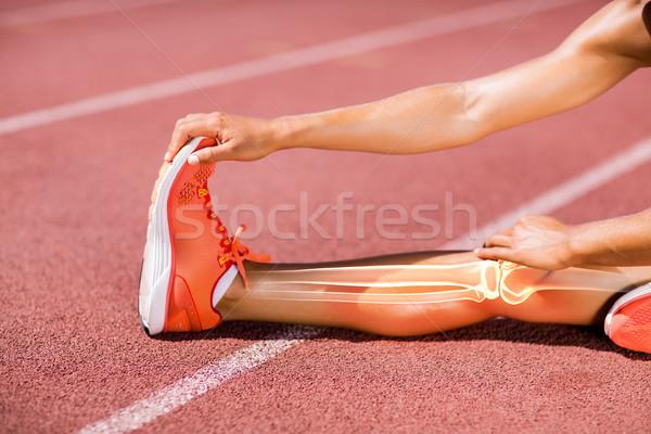 Low section of female athlete stretching on track Stock photo © wavebreak_media