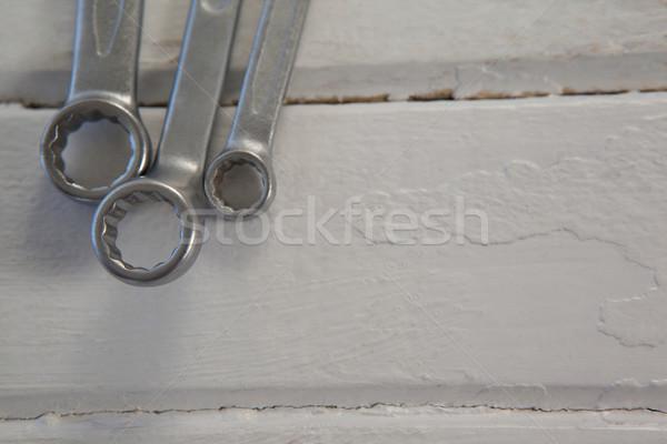 Wrenches arranged on wooden plank Stock photo © wavebreak_media